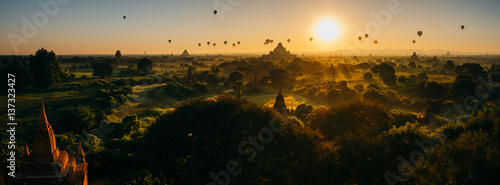 Scenic sunrise with many hot air balloons above Bagan in Myanmar Canvas Print
