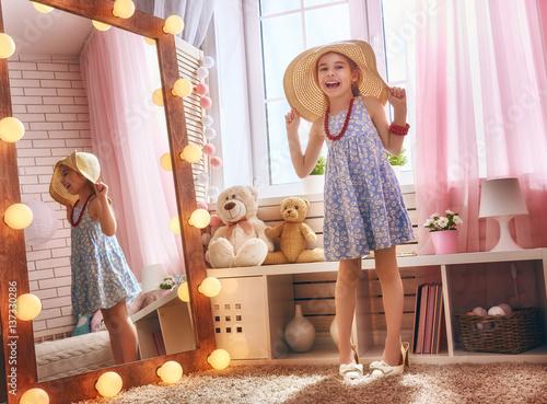 Obraz na plátně  girl dresses up at home