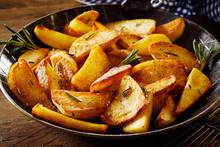 Tasty Crispy Fried Wedges Of Potato With Rosemary