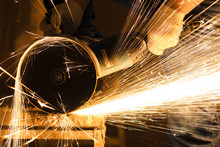 Worker Cutting Metal With Big ...