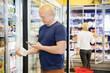 Man Scanning Bar Code On Product Through Mobile Phone