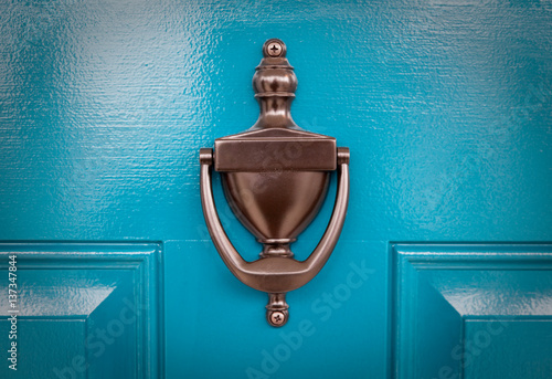Fotomural  Blue Door with knocker close up.