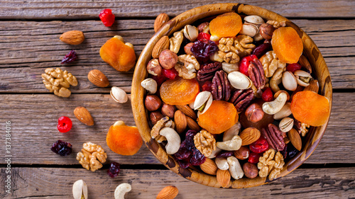 Nuts and dried fruit mix. Concept of Healthy Food. Vintage wooden background. Copy space for Text. selective focus