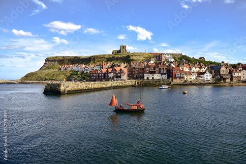 Boat returning to Whitby Harbour Canvas Print