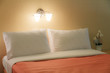 Close up of a bed and pillow with lamp light, Vintage style.