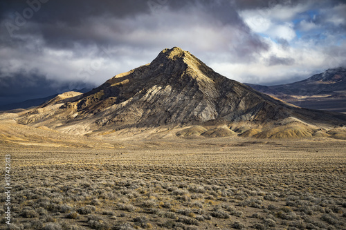 Fotografie, Obraz  Mountain in the Nevada Desert with dramatic light and clouds