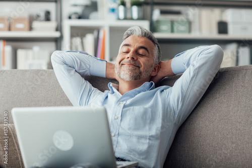 Deurstickers Ontspanning Man relaxing at home