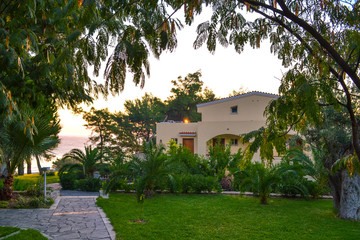 The house by the sea among green plants. Greek hotel Aegean Melathron, Greece - September, 2013.