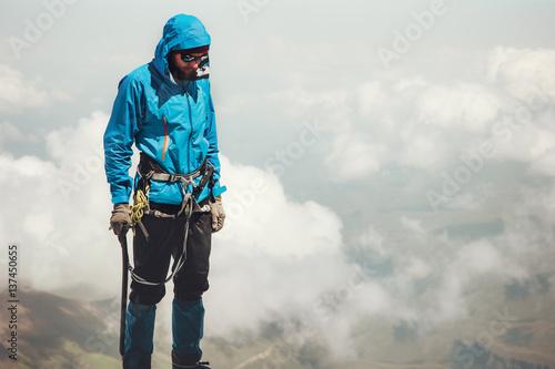 Man climber on mountain summit Travel Lifestyle concept adventure active vacatio Canvas Print