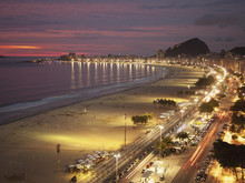 Copacabana Beach And Avenue Atlantica In The Evening; Rio De Janeiro, Brazil
