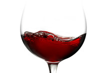 Red Wine In A Glass Isolated O...