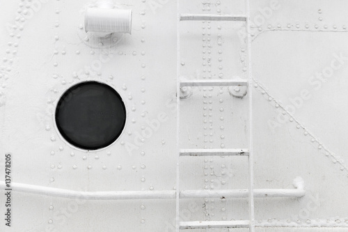 Canvas Prints Ship Hull fragment with ladder and porthole