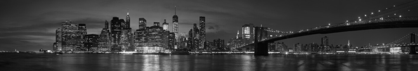Naklejka New York city with Brooklyn Bridge, iconic skyline panorama at night in black and white