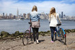 Two young women with bicycles