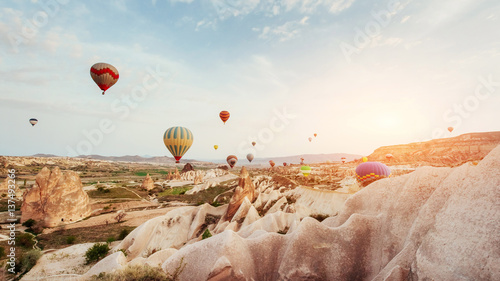 Hot air balloon flying over rock landscape at Cappadocia Turkey. Canvas Print