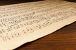 Leinwanddruck Bild - Yellowed from time sheet music notation. Manuscript