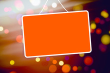 Red Sign Hanging On Abstract Background
