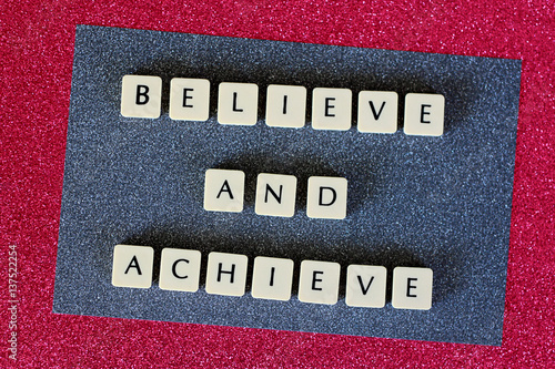 Fotografie, Obraz  Believe and Achieve Letters On Grey and Pink Glitter Background