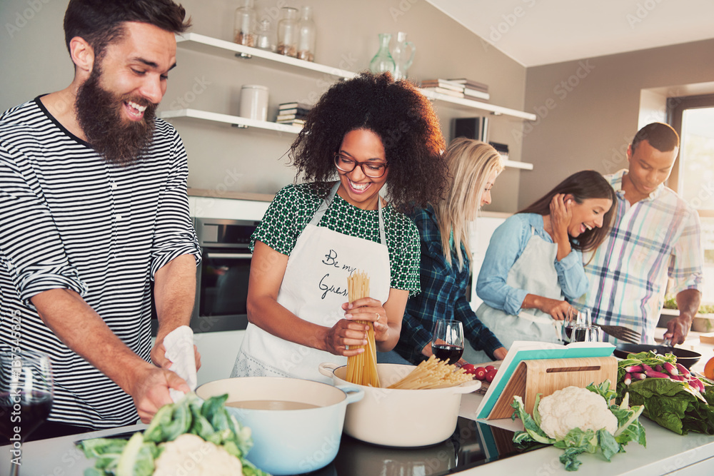 Fototapety, obrazy: Group of friends cheerfully cooking