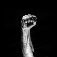 Strong Male Man Raised Fist On...