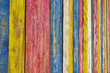 Background from multi-colored vertical wooden planks. Basic bright heaven background for design