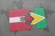 puzzle with the national flag of latvia and guyana on a world map