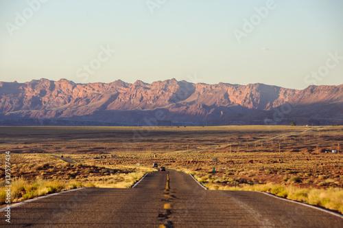 Leinwand Poster Road stretches into the horizon at sunset, Arizona, USA