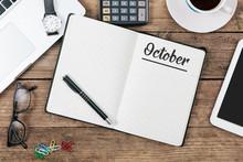 October On Note Book At Office Desktop