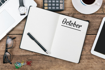 October on note book at office desktop