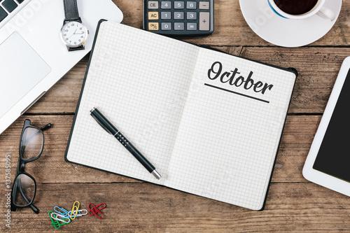 Obraz October on note book at office desktop - fototapety do salonu