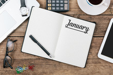 January On Note Book At Office Desktop