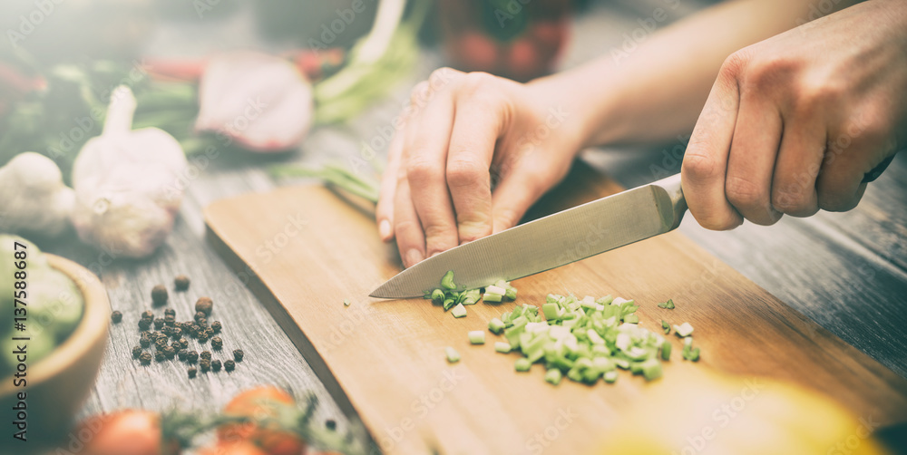 Fototapety, obrazy: The chef slicing vegetables.