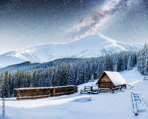 Fototapety, obrazy: chalets in the mountains at night under the stars.