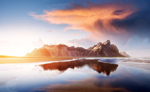 Amazing Mountains Reflected In The Water At Sunset. Stoksnes