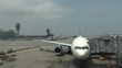 4k, Ground crew busy getting a plane ready to fly at the hongkong airport -Dan