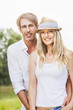 Happy young couple, woman with straw hat, Bavaria, Germany