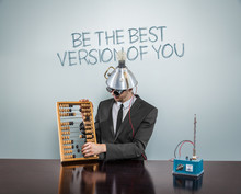Be The Best Version Of You Text On Blackboard With Businessman