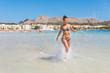 Beautiful woman having fun at seaside in Mallorca