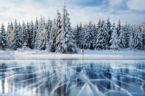 Canvas Prints Mountains Blue ice and cracks on the surface of the .