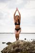Girl doing yoga in Bali Indonesia