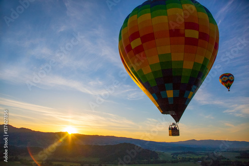 Hot Air Balloon Over Vineyards At Sunrise Over Napa Valley, Napa, California USA