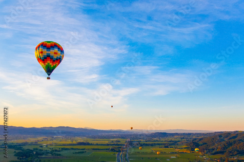 Aluminium Prints Balloon Hot Air Balloon Over Vineyards At Sunrise Over Napa Valley, Napa, California USA