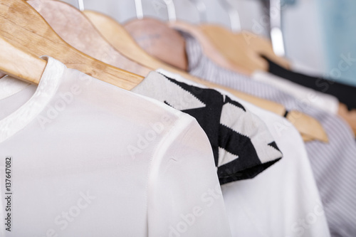 6465a2d8fef black and white womens clothes on hangers on rack in fashion sto ...