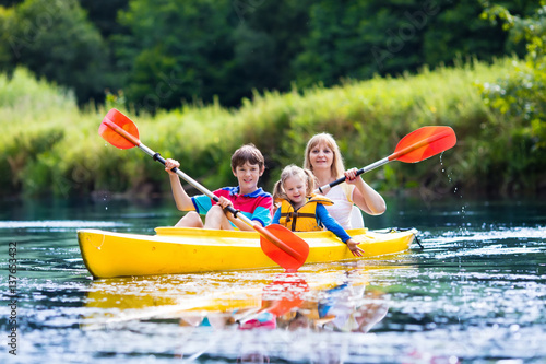 Family enjoying kayak ride on a river Canvas Print