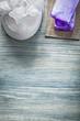 Purple handmade soap white bath sponge on wooden board spa treat