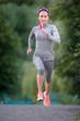 Female Athlete runs at a marathon distance
