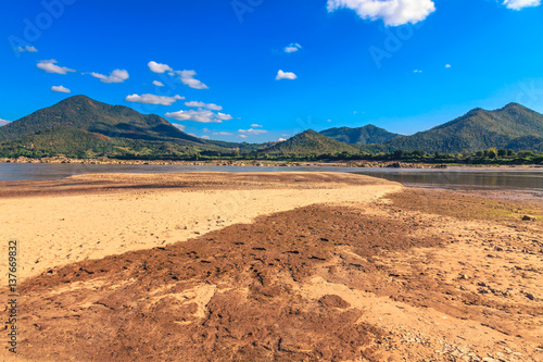Fotografie, Obraz  Landscape of mountain with river and large land bank.