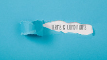 Terms And Conditions Message On Paper Torn Ripped Opening