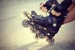 Leinwanddruck Bild - Setting of laces on roller skates