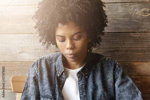 Portrait Of Sad Young African Female With Stylish Haircut Dressed In